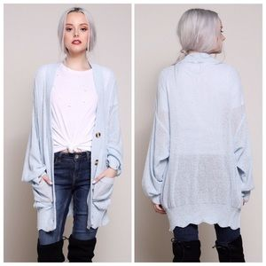 Raw Cut Knitted Cardigan